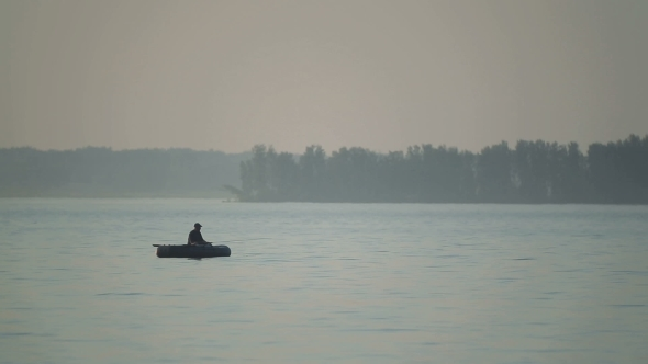 VideoHive Silhouette Of a Fisherman On a Boat 12190450