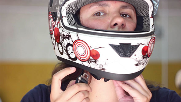 VideoHive Woman Put on Helmet and Fasten it 12191732