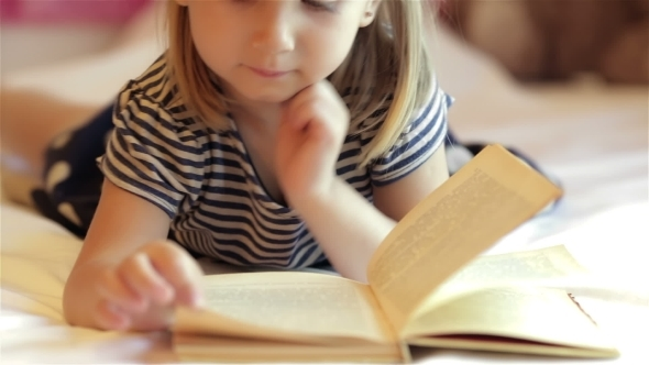 VideoHive Little Girl Reading Book 12192302
