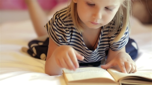 VideoHive Little Girl Reading Book 12192303