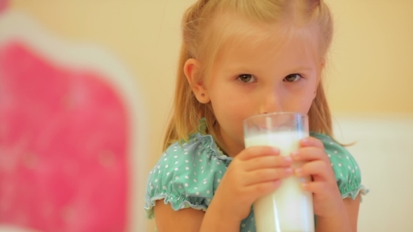 VideoHive Adorable Little Girl Drinking Milk 12192312