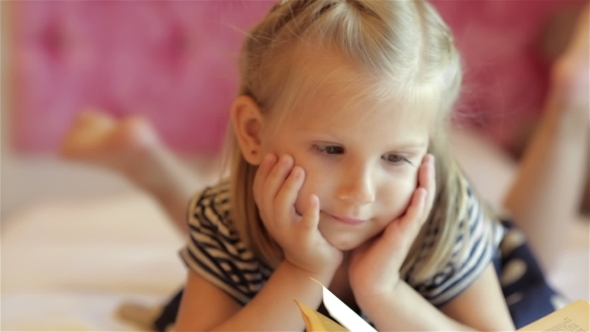 VideoHive Little Girl With a Book 12192313