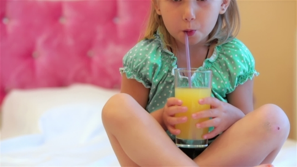 VideoHive Adorable Little Girl Drinking Juice 12192314