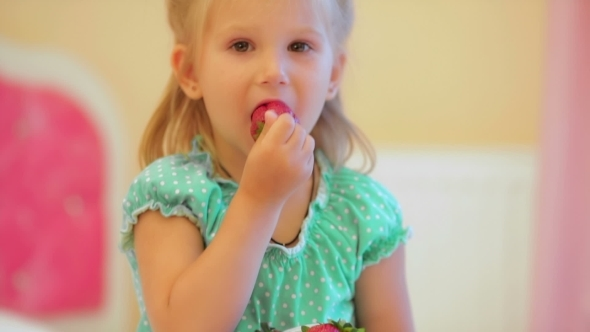 VideoHive Adorable Little Girl Eating Strawberries 12192341