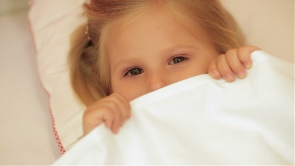 VideoHive Cute Little Girl Under The Blanket 12192343