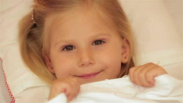 VideoHive Cute Little Girl Under The Blanket 12192427