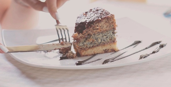 VideoHive Woman Eating Cake In Restaurant 12200407