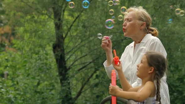 VideoHive Grandmother And Granddaughter In A Park 12203386