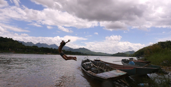 VideoHive Boy Jumping From A Boat 12206551