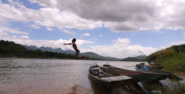 VideoHive Kid Jumping Into River 12206568