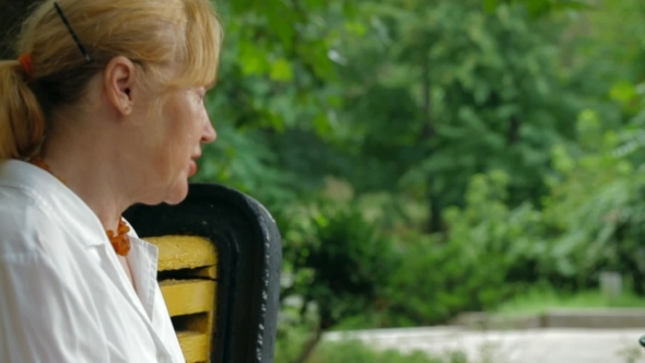 VideoHive Seating On A Bench In The Park 12206643