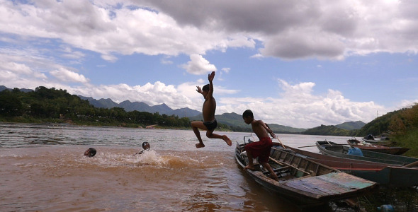 VideoHive Children Jumping Into River 12206665