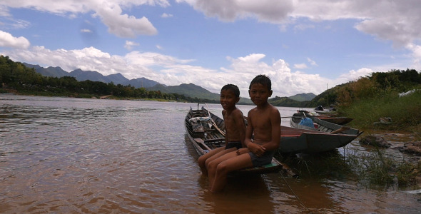 VideoHive Two Boy Sitting On A Boat 12208434