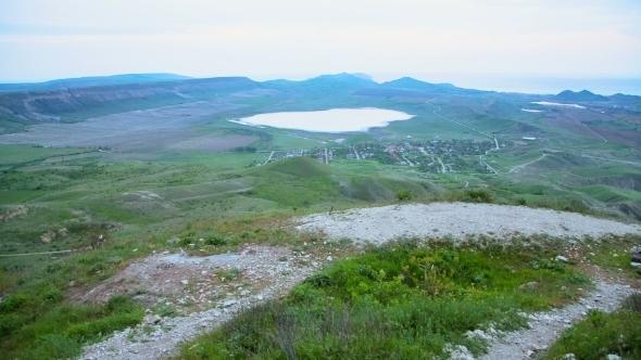 VideoHive Mountain Biker Admiring Hilly Terrain 12210133