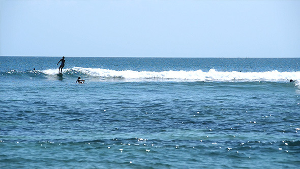 VideoHive Surfers in Small Waves in Bright Ocean 12210319