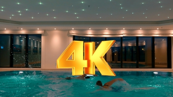 VideoHive Man And Woman Swimming In The Indoor Pool 12211766