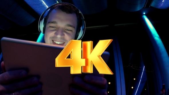 VideoHive Man Enjoying Music With Pad At Sky Deck At Night 12211792