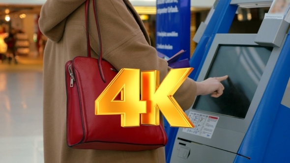 VideoHive Woman Doing Self-check In At The Airport 12211852