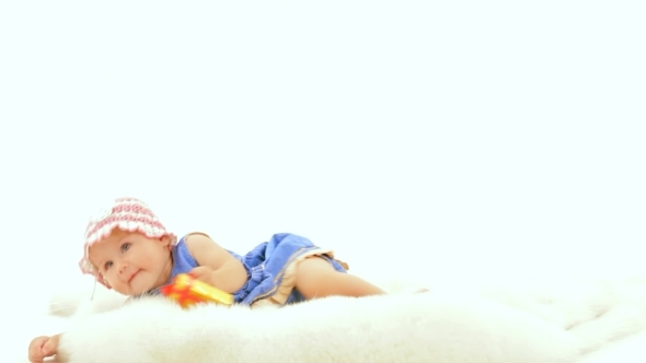 VideoHive The Baby Girl Is Lying On a White Background 12212390