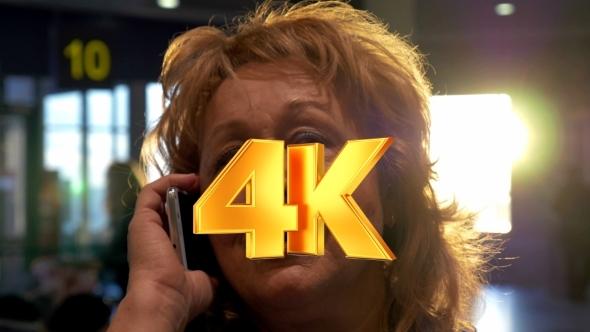 VideoHive Senior Woman Having a Vivid Phone Talk At Airport 12212465