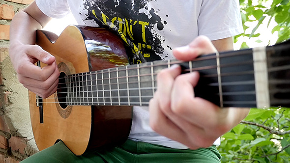 VideoHive Young Man Playing A Guitar Solo 12216846