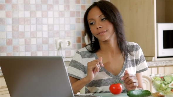 VideoHive Housewife Looking For The Recipe In Her Computer 12218749