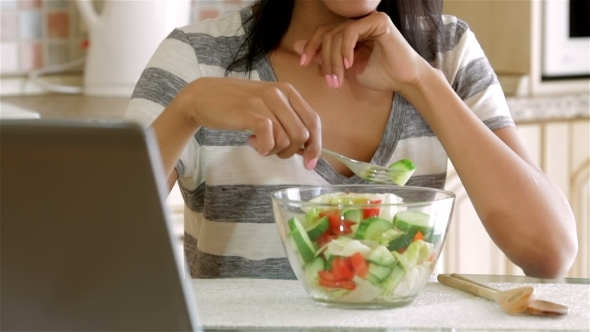 VideoHive Housewife Eating Salad 12218798