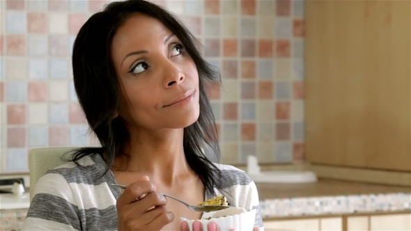 VideoHive Beautiful Lady Eating Cereals At Home 12219139