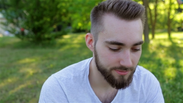 VideoHive Casual Young Man Using a Phone In The Park 12221258