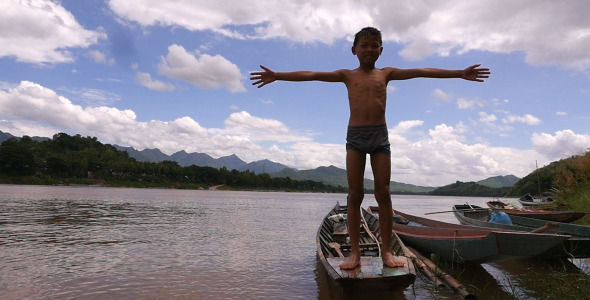 VideoHive Poor Kid With Hands Up On A Boat 12222076