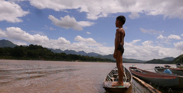 VideoHive Boy Standing On A Boat 12222228