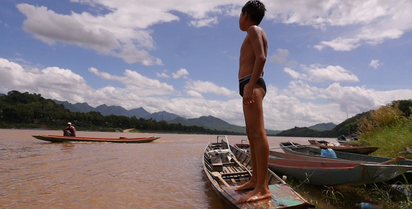 VideoHive Young Boy Standing On A Boat 12222973