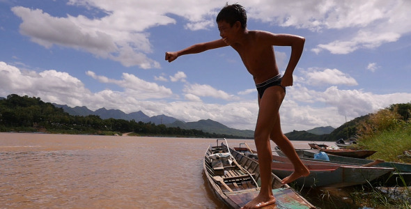 VideoHive Young Boy Training Boxing On A Boat 12223305