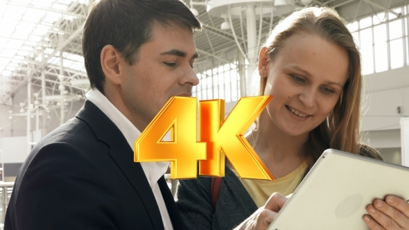VideoHive Young Happy Man And Woman Talking On Business With 12228231