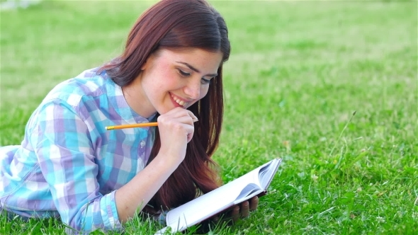 VideoHive Beautiful Girl With Her Diary In Park 12229084