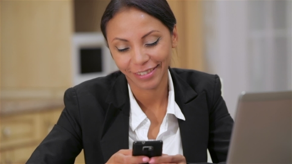 VideoHive Busy Business Woman Texting On Her Cell Phone 12229088
