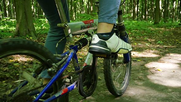 VideoHive Boy Biking On Forest Trails 12231982