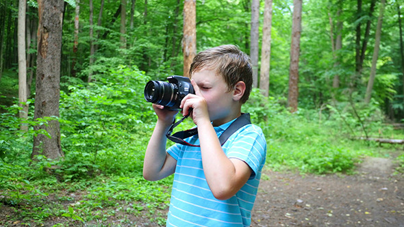 VideoHive Boy In Wilderness Area Taking Picture 12231993
