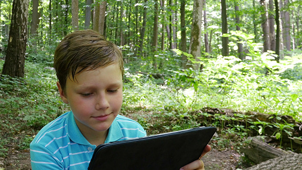 VideoHive Boy With Tablet In The Forest 12231999
