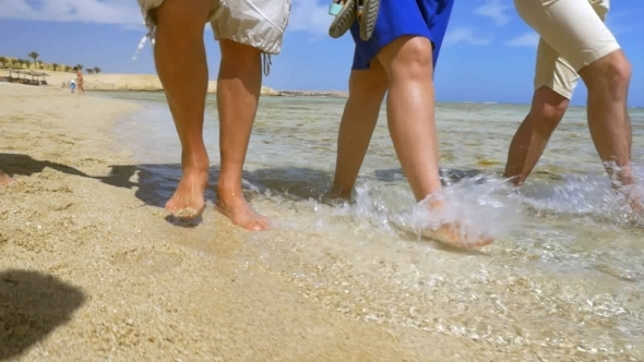VideoHive They Enjoying Warm Water And Sand On The Coast 12237276