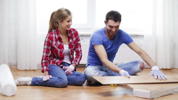VideoHive Happy Couple Measuring Wood Flooring Board At Home 12239126