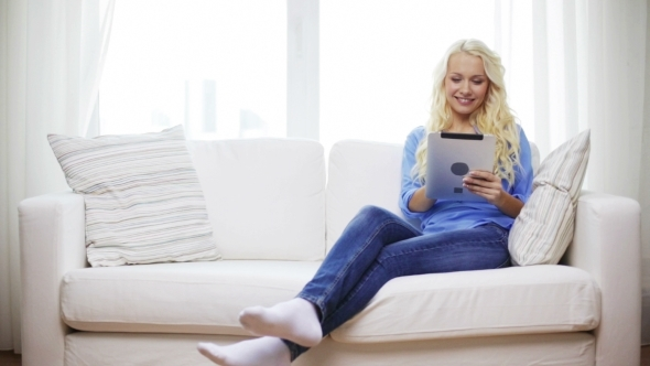 VideoHive Smiling Woman With Tablet Pc Computer At Home 12239134