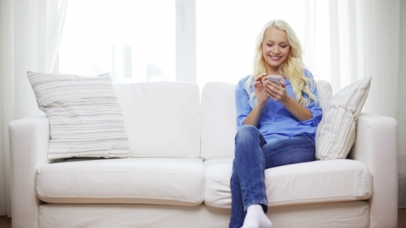 VideoHive Smiling Woman With Smartphone At Home 12239169