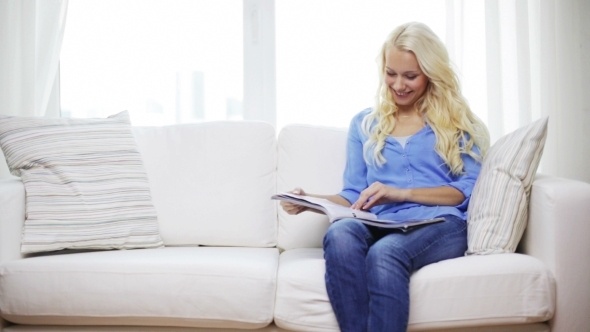 VideoHive Happy Woman Reading Magazine At Home 12239229