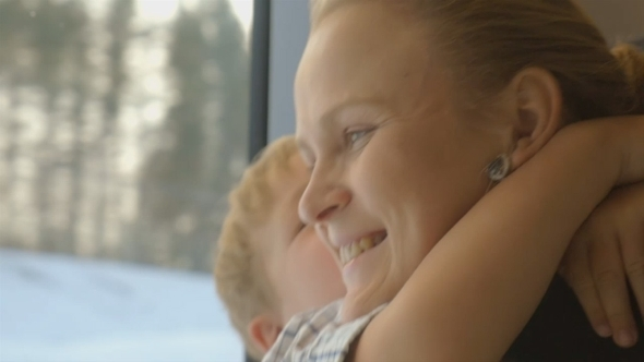 VideoHive Little Child Embracing Mother In Train 12248101