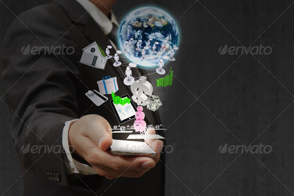 business light bulb hand pushing on a touch screen interface - Stock Photo - Images
