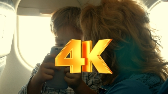 VideoHive Child And Grandmother Entertaining With Phone In 12251673