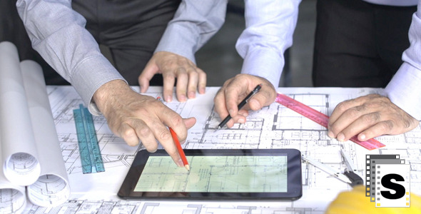 VideoHive Architects Working On Blueprints And Tablets 12253399