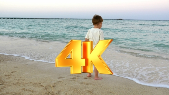 VideoHive Boy Standing In The Incoming Waves 12253562