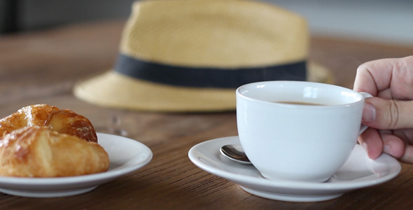 VideoHive Drinking a Hot Cup of Coffee 12254346